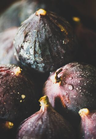 Fresh ripe seasonal harvested wet purple figs, selective focus, close-up