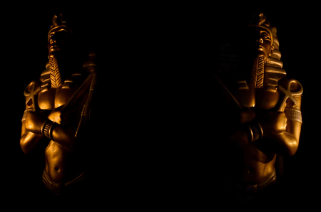 Statues of king pharaoh gods dead religion symbol isolated on black background.