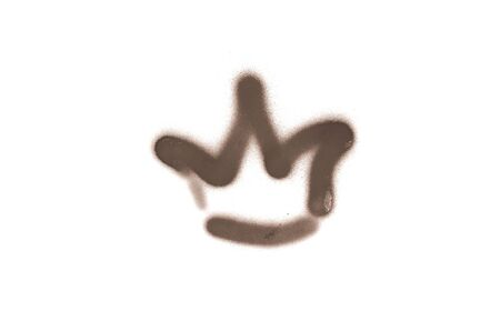 Graffiti crown sign sprayed on white isolated background. Corona symbol painted in street art tag style in brown color