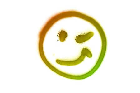Graffiti smile sign sprayed on white isolated background. Symbol painted in street art tag style in trendy colors