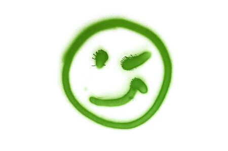 Graffiti smile sign sprayed on white isolated background. Symbol painted in street art tag style in light green color