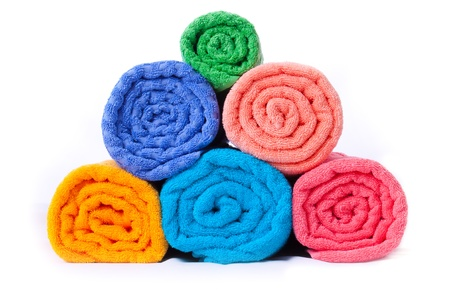 Colorful towels isolated on a white background photo