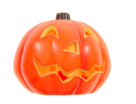 caving: plastic pumpkin with caving face Stock Photo
