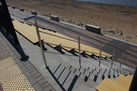 View of the stairs on the embankment  Descent to the shore  Beautiful architectural decision of the descent to the beach