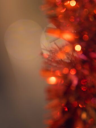 Abstract red New Years tinsel on a dark background