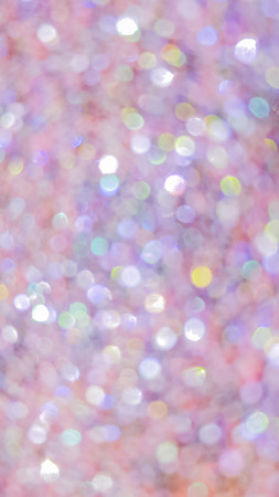 Multicolored abstract bokeh lights. Blurred shiny background Banco de Imagens