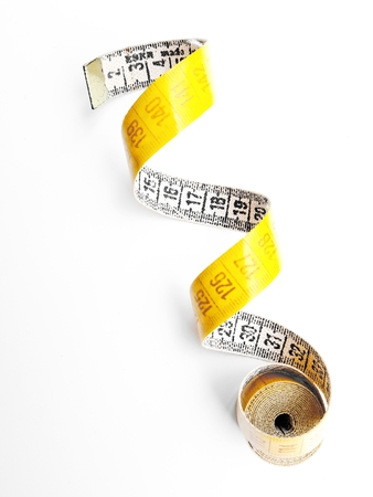 Yellow measuring tape isolated on white background. 写真素材