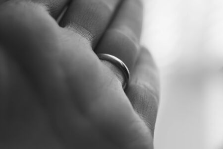 young female hand, palm macro photo, ring on the ring finger, bw 版權商用圖片