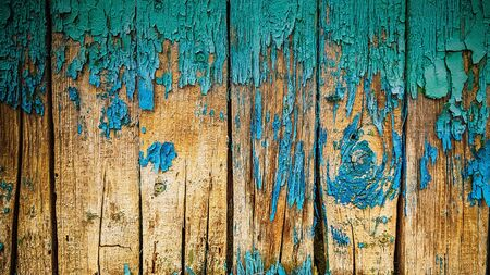 wooden background with a blue shabby paint