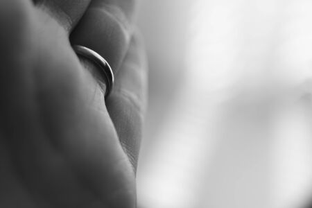 young female hand, palm macro photo, ring on the ring finger, bw photo. 版權商用圖片