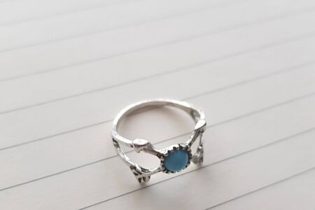ring mascot with a turquoise stone on paper. 版權商用圖片