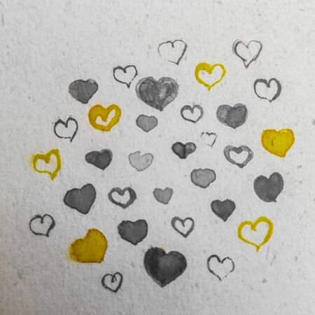 Love card. Painting many gray and yellow hearts on old paper