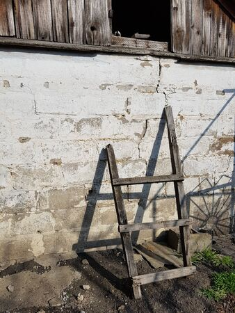 Wooden staircase to the loft of the barn. Sunny day Stock Photo