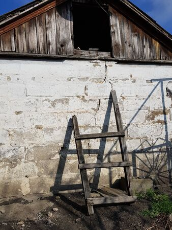 Wooden staircase to the loft of the barn. Sunny day Фото со стока