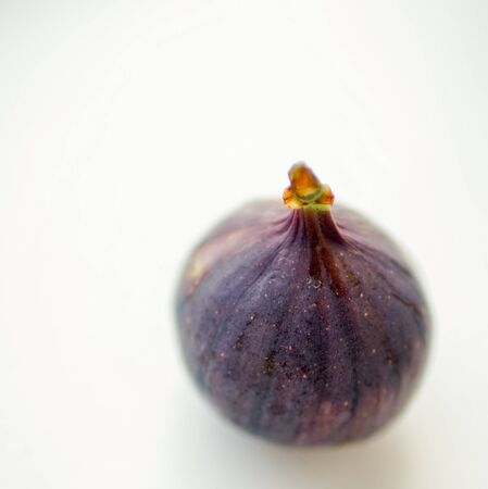 Ripe sweet fig on white blurred table. Selective focus. Stock fotó