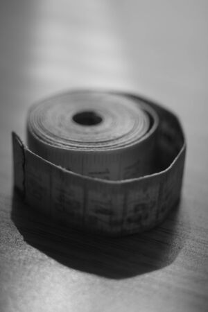 Measuring tape on the table. Black and white photo 版權商用圖片