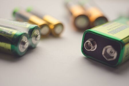 Different types of batteries on the table close-up