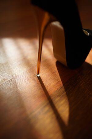 fashion black women high heel on the sunny floor, light and shadow
