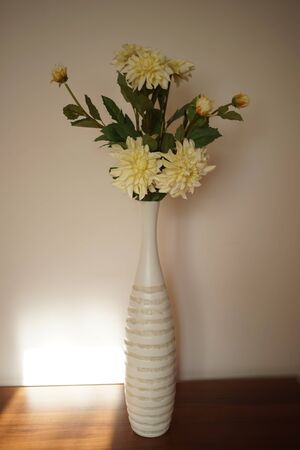 Tall vase of flowers on a table in the living room