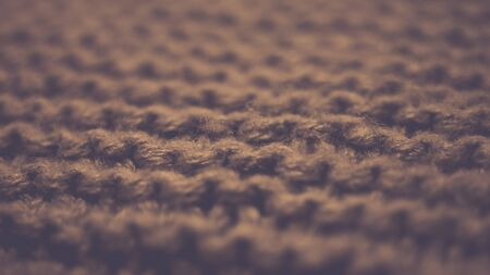 Knitted texture, brown thread pattern, cozy winter background