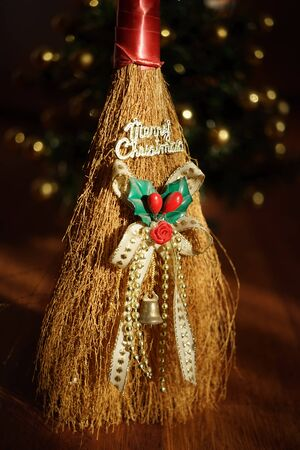 Broom toy with golden text Merry Christmas. New Year Card Imagens