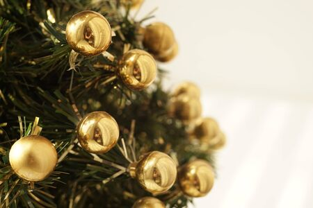 Christmas tree decorated with golden balls closeup