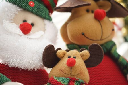 Friendly company of Santa Claus and his animal friends, smiling soft toys, New Year card Imagens