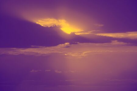 Defocused image of an sunrise in the clouds. Sunset sky