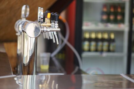Chrome beer taps in a summer bar