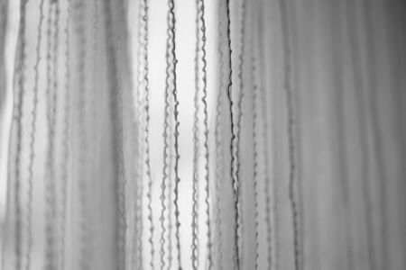 Delicate tulle with vertical threads pattern, side view, bw photo 스톡 콘텐츠