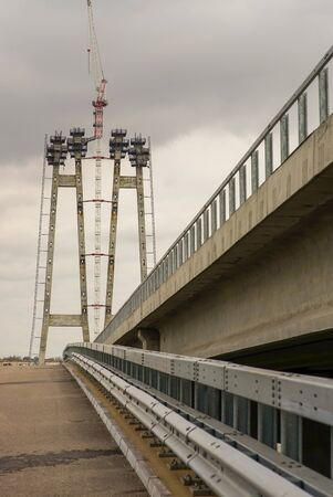City bridge construction with road and crane 스톡 콘텐츠