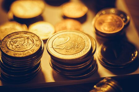Stacks of iron golden coins on the table