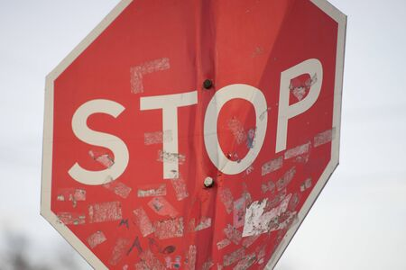 Old dirty bent road stop sign close-up
