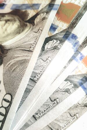 One hundred dollar bills closeup as background