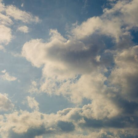 Blue sky with sunny white grey clouds, autumnal heavens