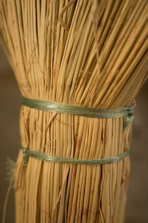 new wicker broom handle closeup with green ropes 스톡 콘텐츠
