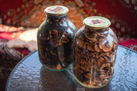 Two glass jars with dried fruit for compote