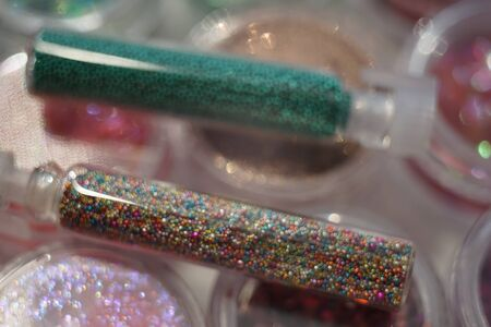 Set of various materials for the design of nails in glass tubes, nail art rhinestones