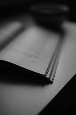 Open book on the table. Side view. BW photo Zdjęcie Seryjne - 140595238