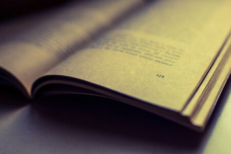 Open book on the table. Closeup, side view