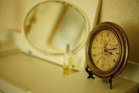 Vintage Parisian clock close-up in a romantic room Imagens