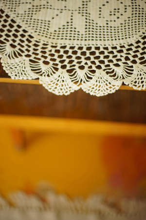 crocheted white napkin on the wooden table