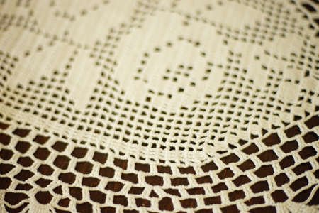 White crocheted napkin with floral pattern close up