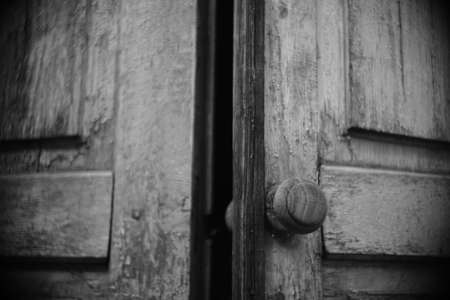 old wooden doors with round handle.
