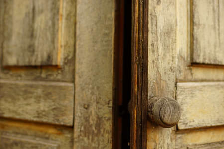 old shabby wooden door with a round knob