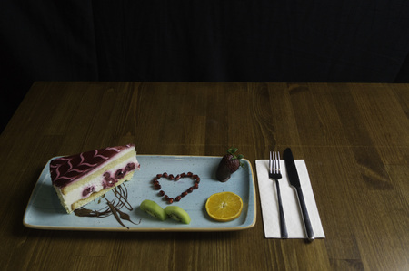 In carefully crafted serving tray cake and sweets