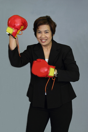 upholster: Business woman upholster shown victory shake their fists. Stock Photo
