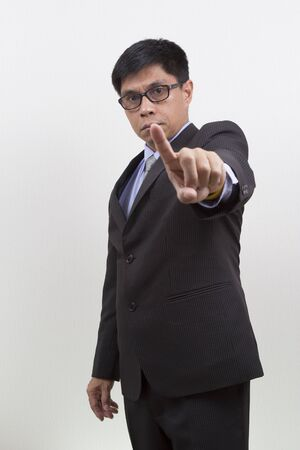 Businessman Gesturing Pointing on White  photo