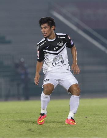 midfielder: BANGKOK ,THAILAND : October 15 : Krerkrit Taweekarn Midfielder of Chonburi FC and Thailand national team players  ARMY Stadium ; inThai Premier League 2014  on 15 October 2014 ,  Bangkok Thailand. Editorial