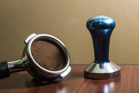 processed grains: Tamping coffee and coffee powder.